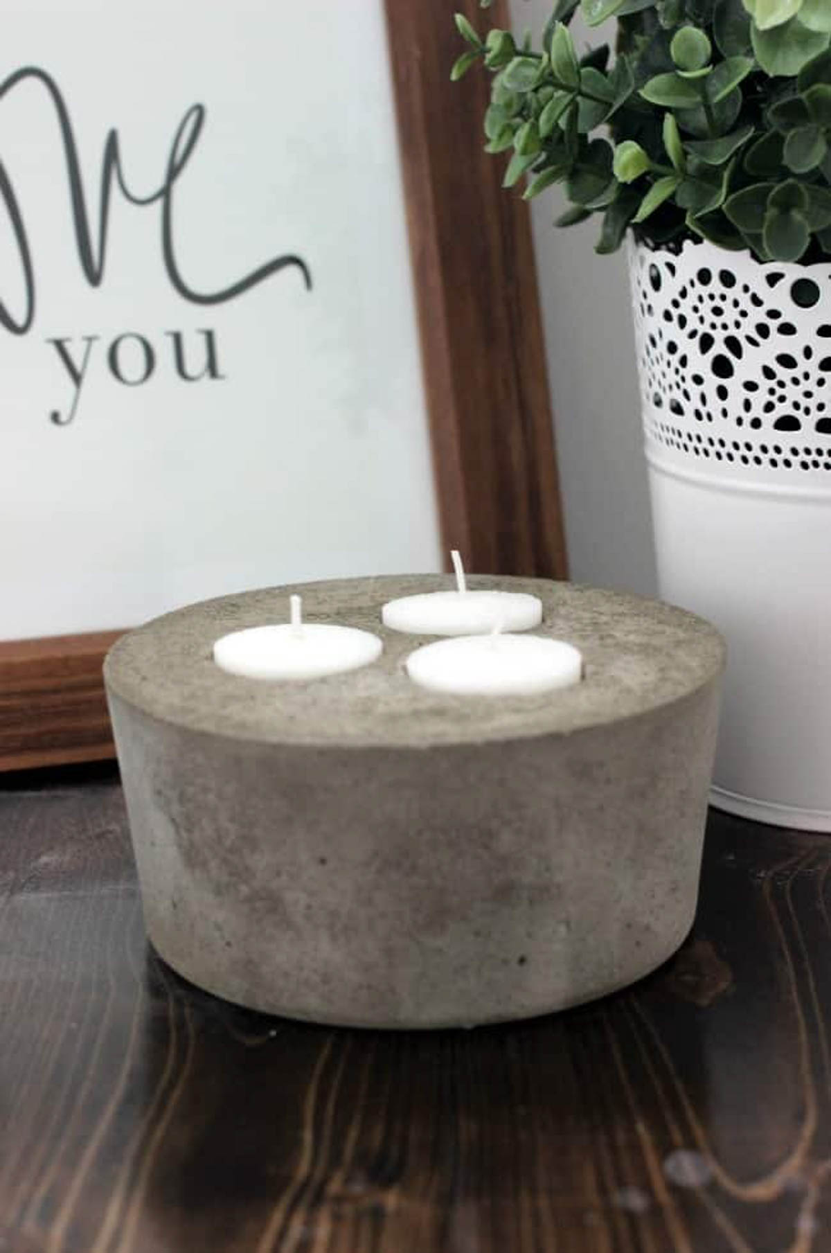 Concrete candle holder with 3 tea light candles
