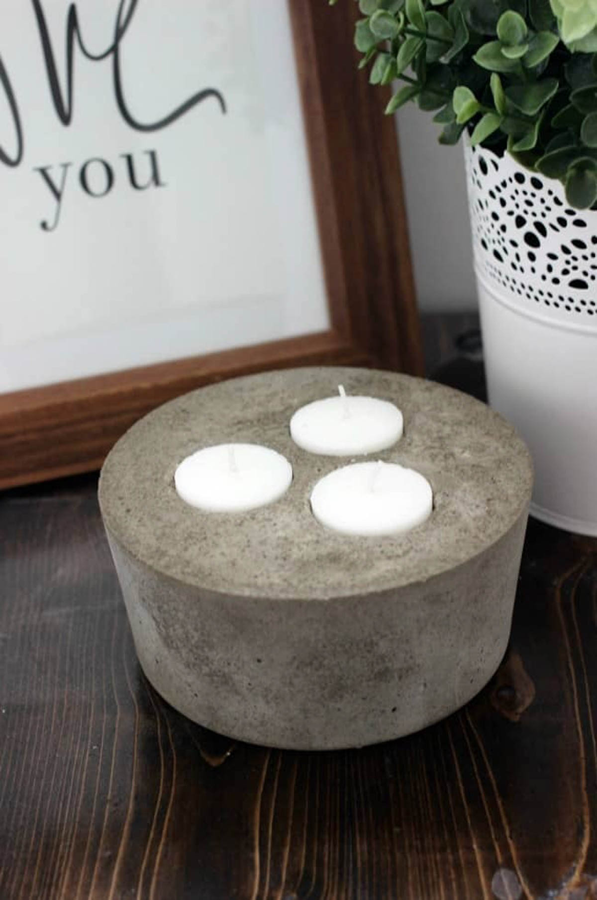 Concrete candle holder with tea light candles