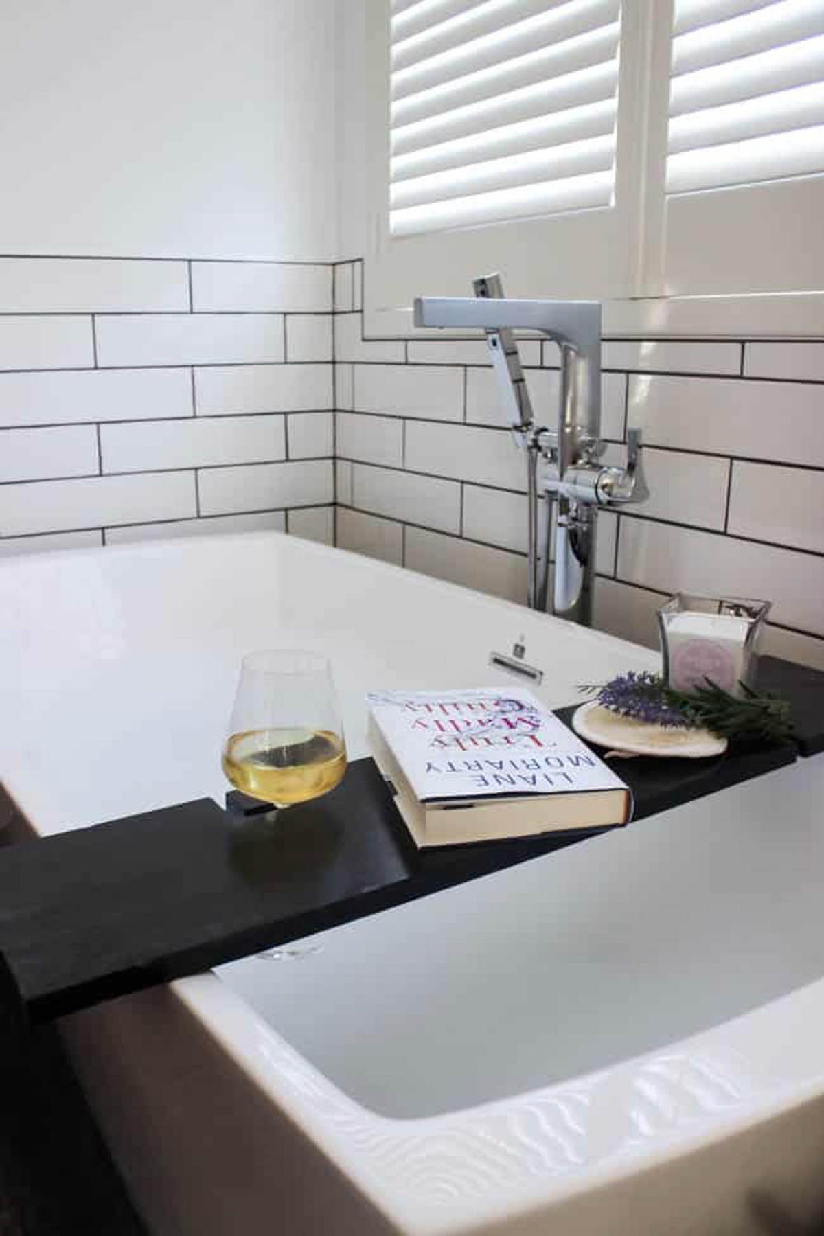 DIY bath tray with book, candle and wine glass