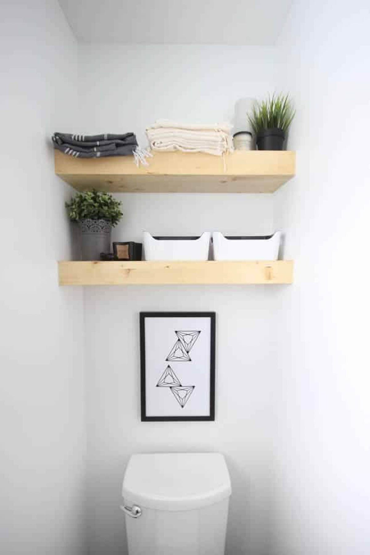 Completely decorated easy floating shelves in a bathroom