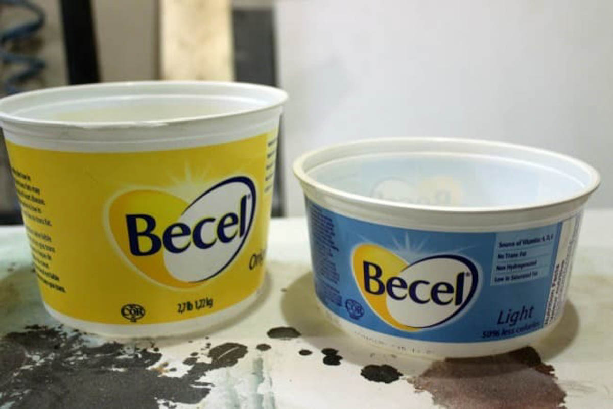 Image of empty butter containers to use as a mold for the concrete candle
