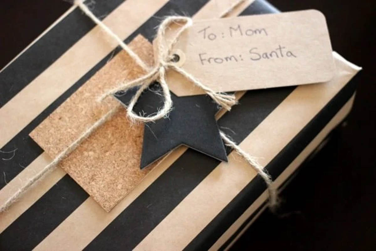Striped rustic gift wrapped present with star and cork tag