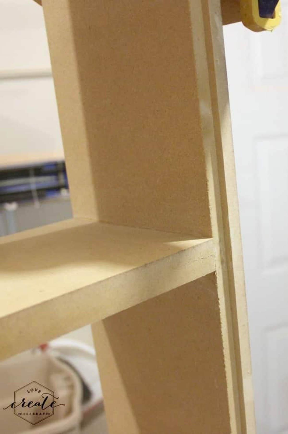 Framed and glued house bookshelf