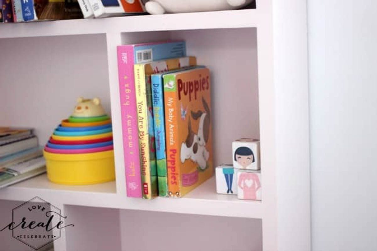 Staged house bookshelf painted pink