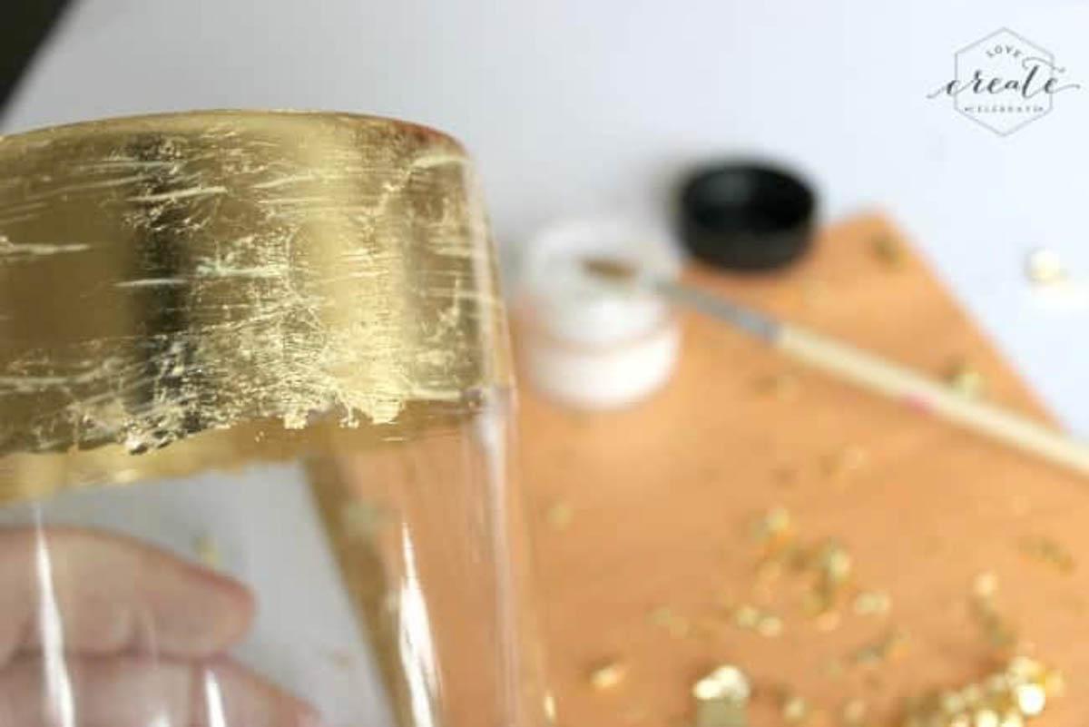 Sealing the gold leaf vase with gold leaf sealer