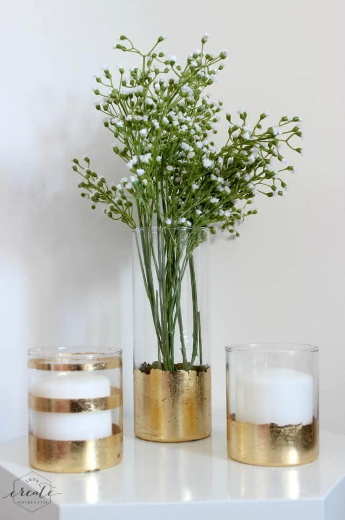 Gold leaf vase with two gold leaf candle holders