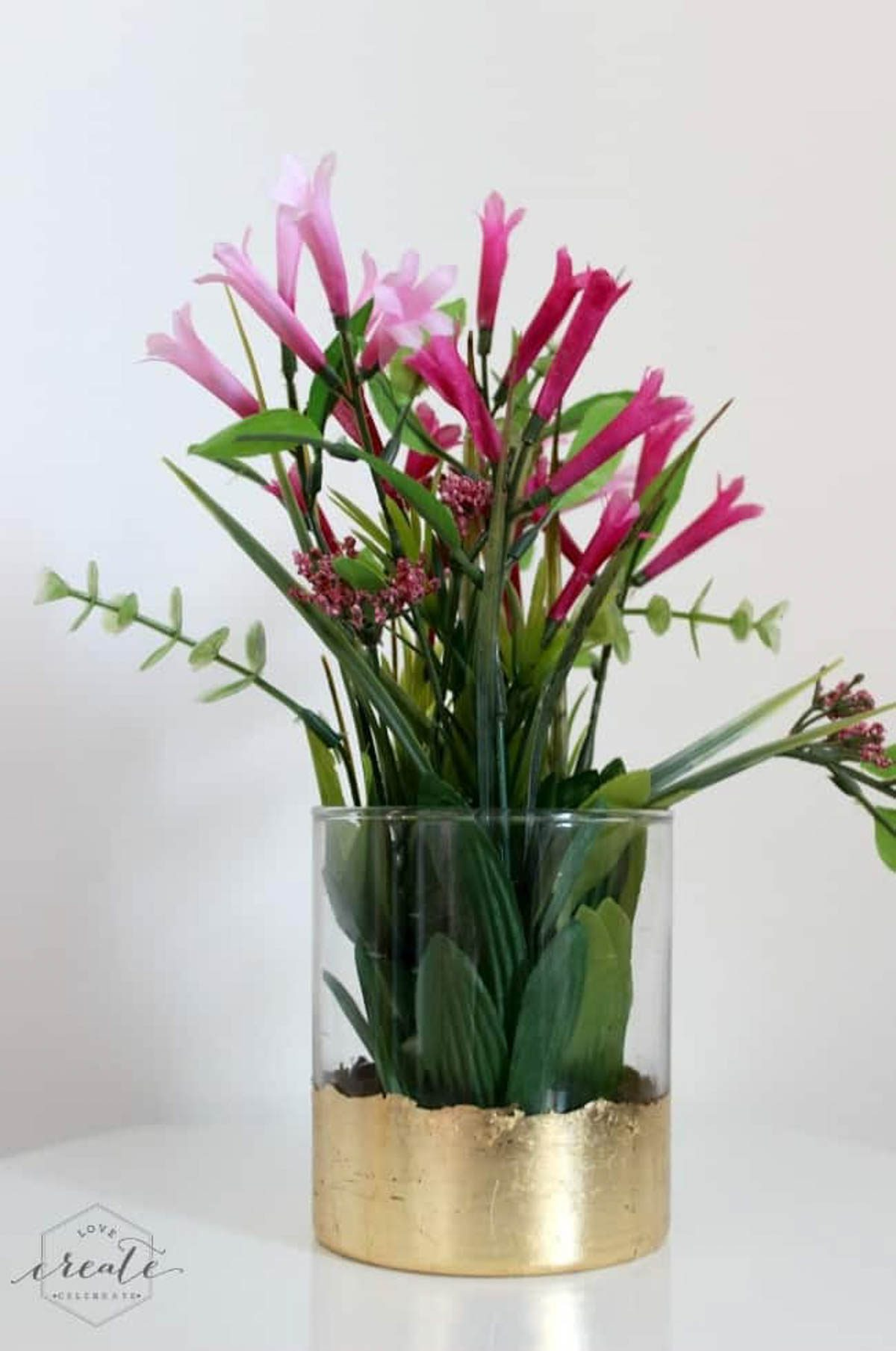 finished gold leaf vase with pink flowers