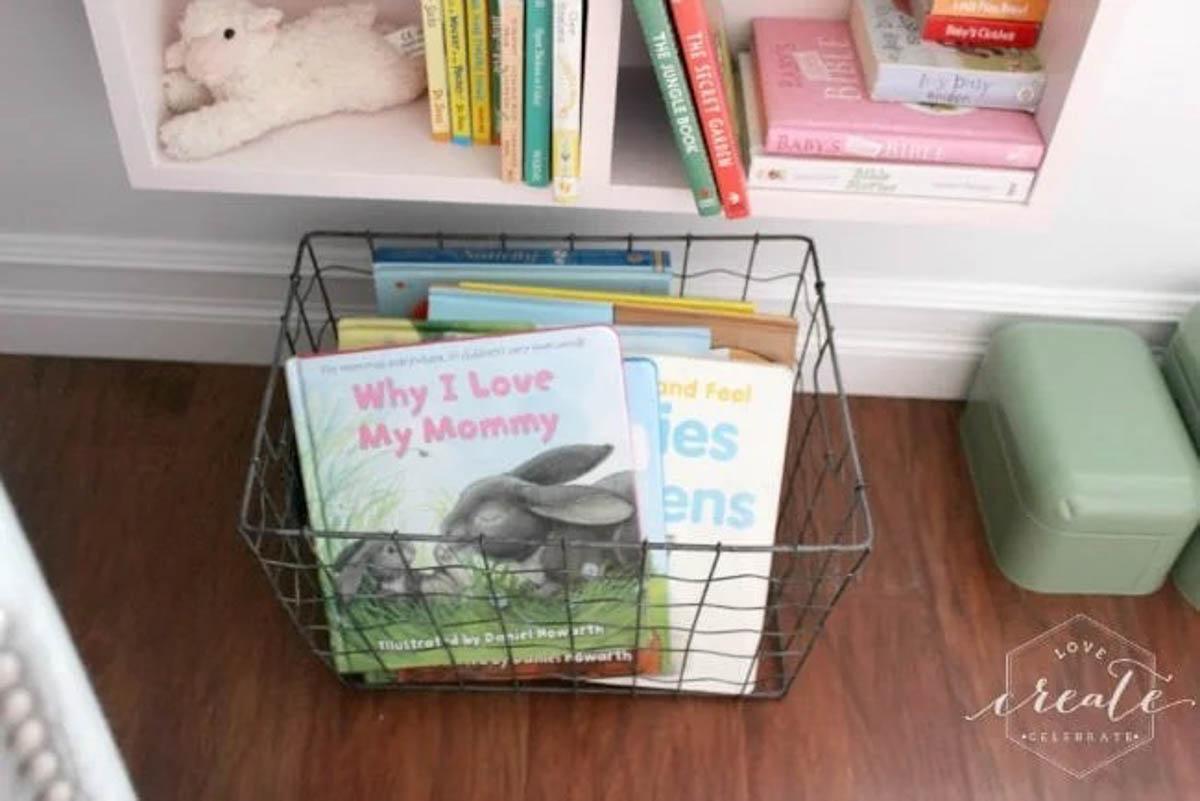 Basket of children's books in front of the house bookshelf