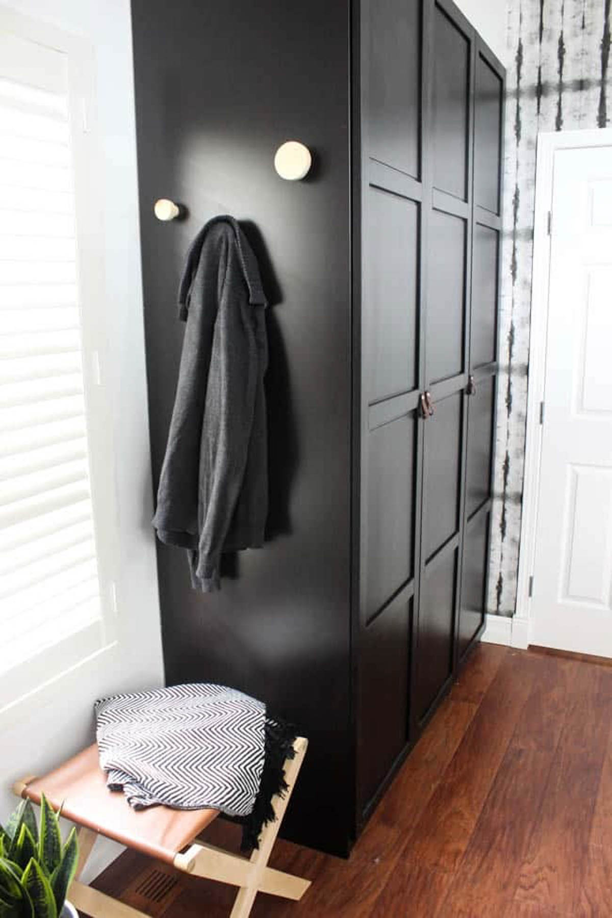 DIY wall hooks attached to a cabinet