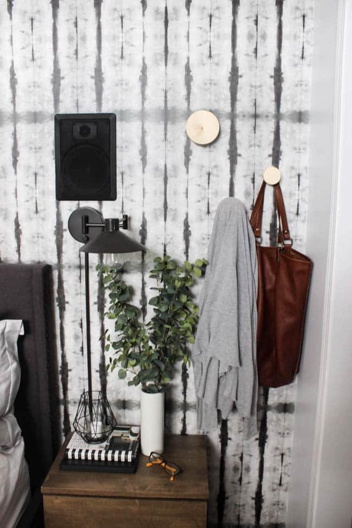 DIY wall hooks holding a bag and sweater