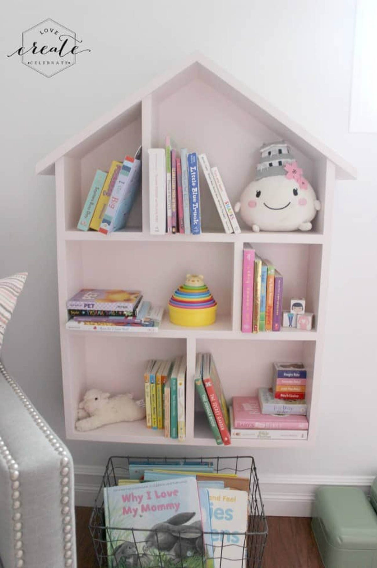 House bookshelf staged with children's books and toys
