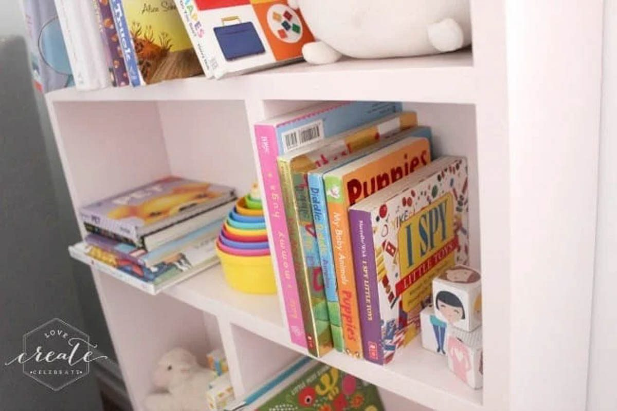 Close up image of books and toys on the house bookshelf