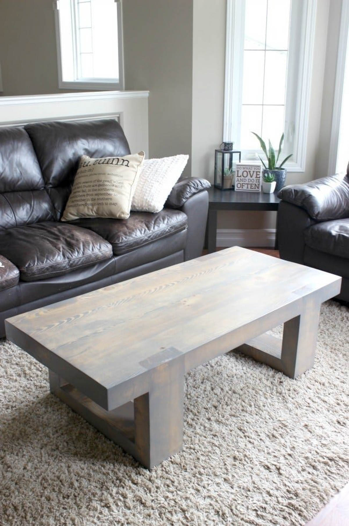 Modern coffee table placed in front of a leather sofa