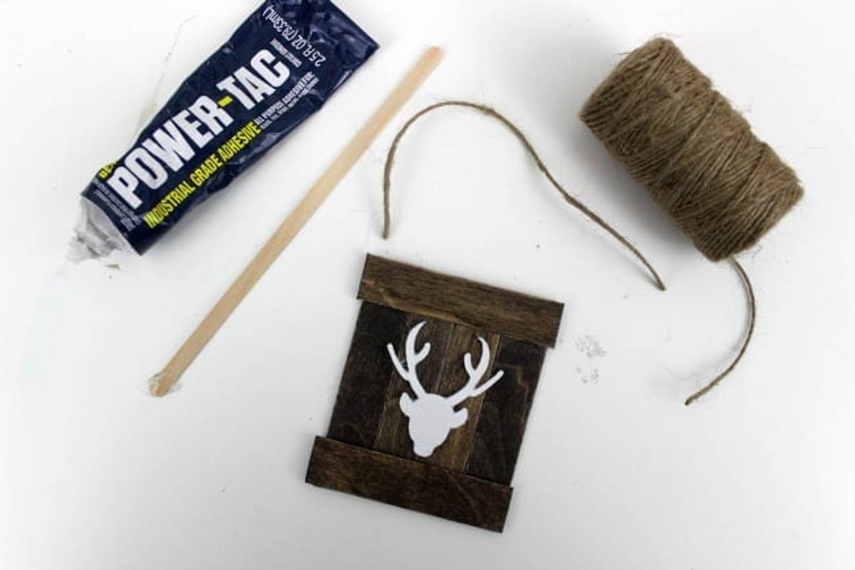Preparing to put twine on the end of the diy reindeer ornament