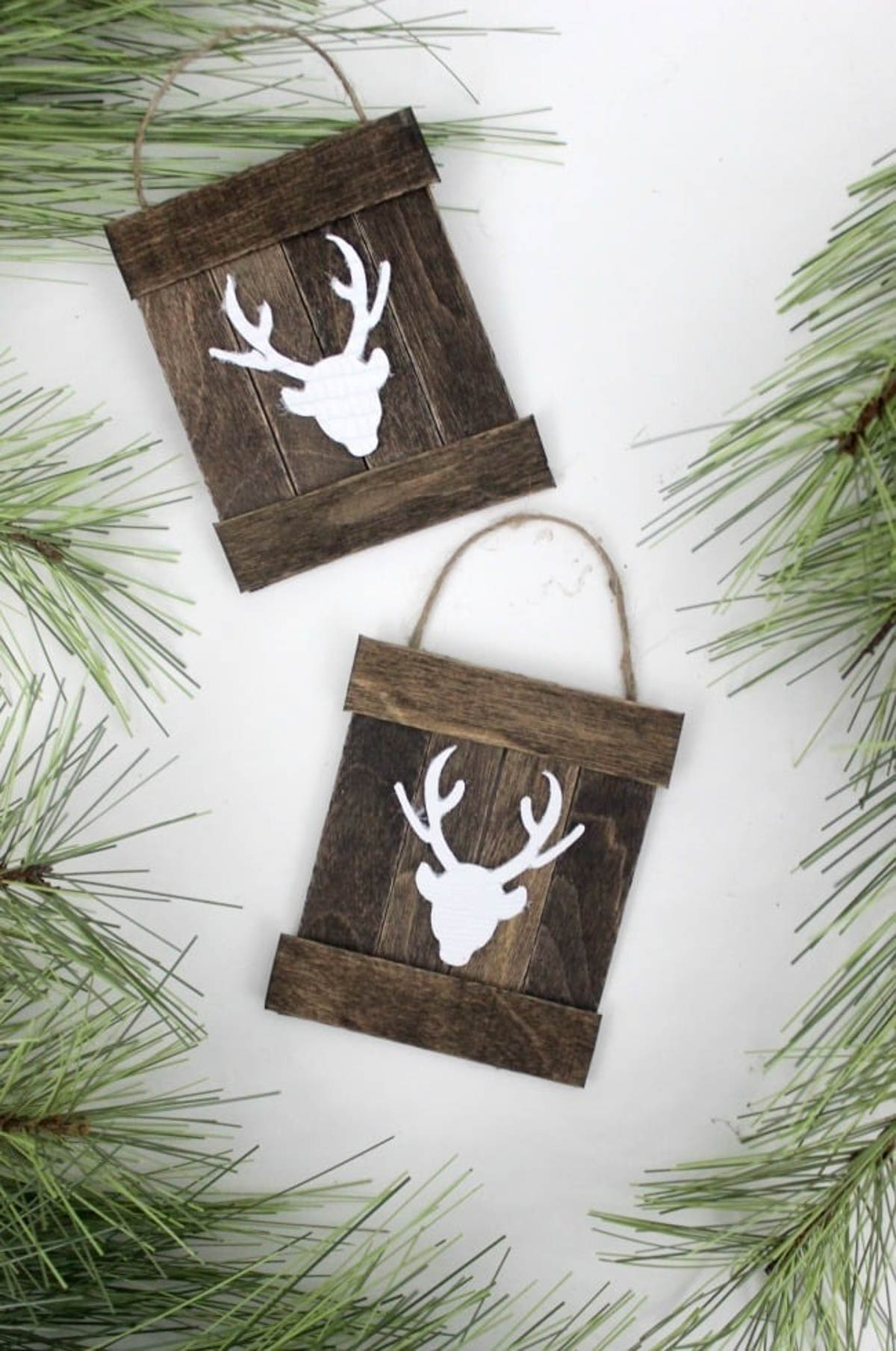 Two completed mini pallet deer ornaments