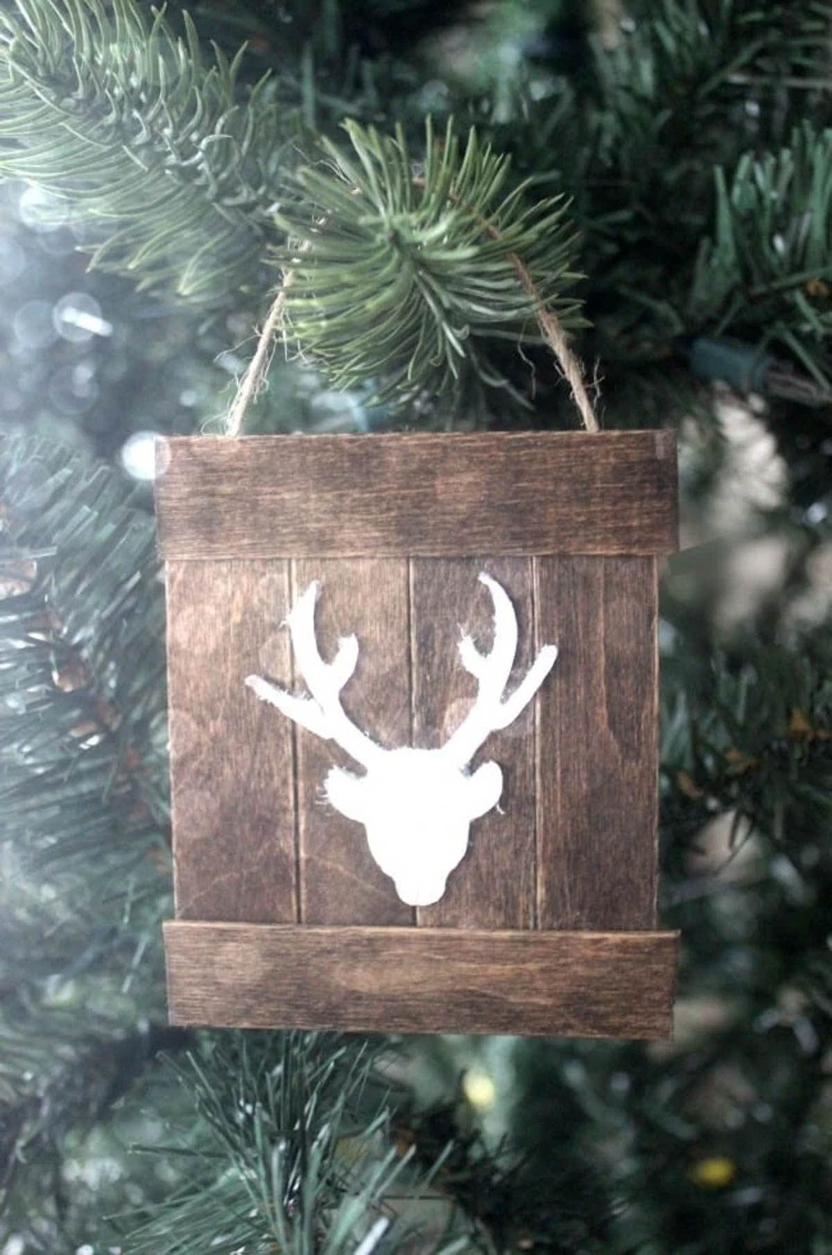 Mini pallet deer ornament hanging on a tree